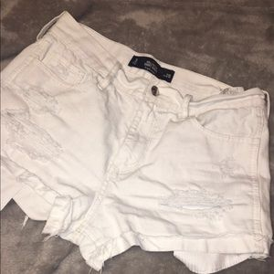 Ripped White Hollister high rise short-shorts